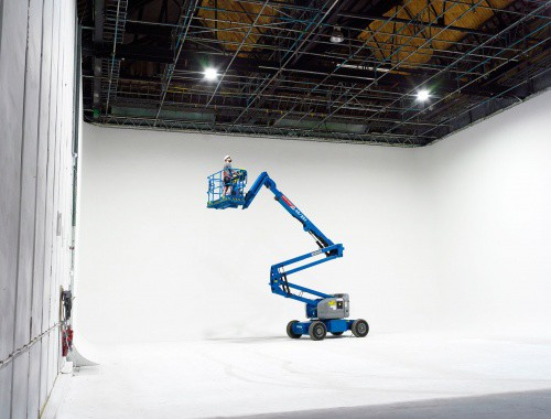 Large white cyclorama film studio with a cherry picker