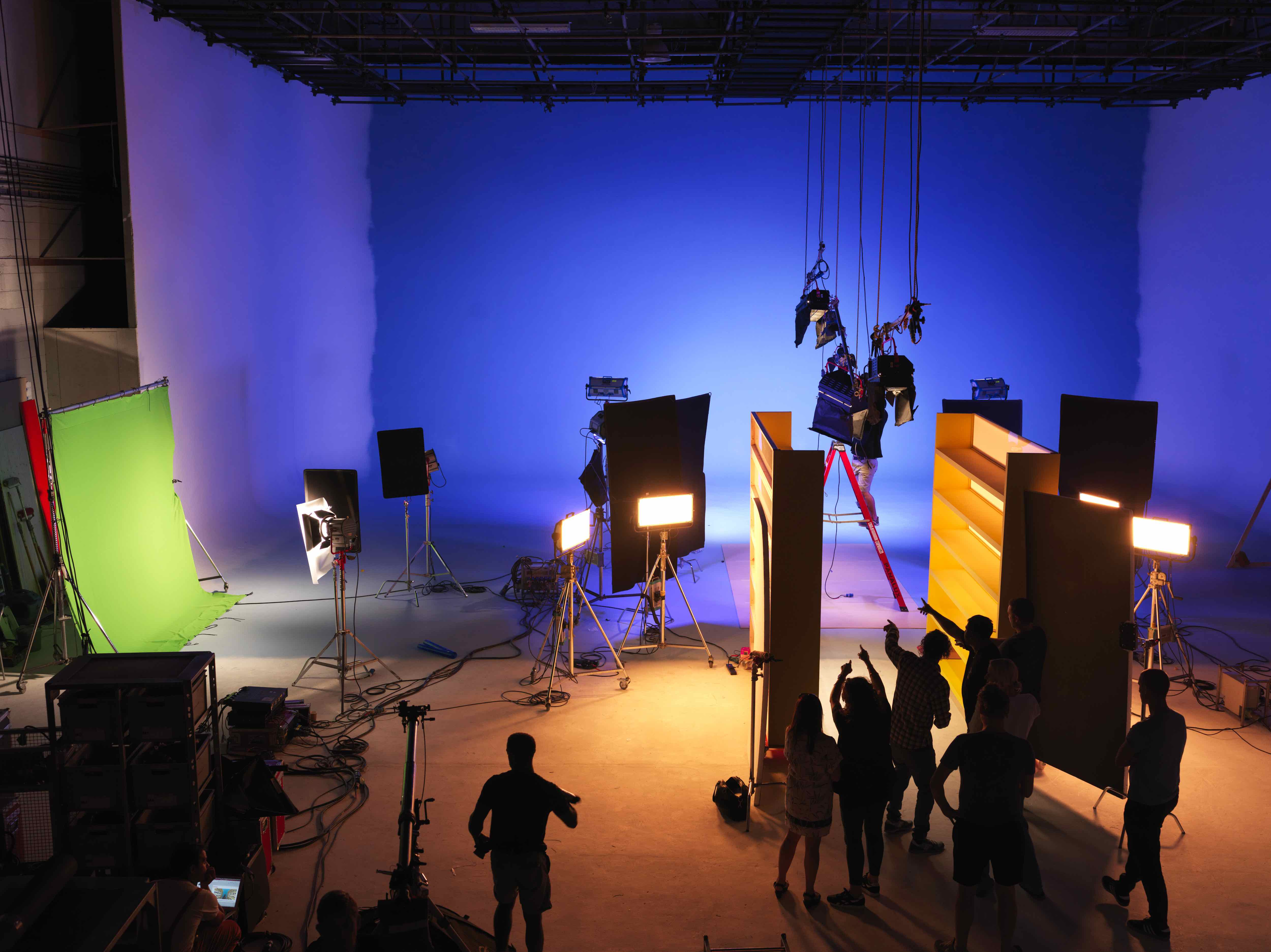 Busy film studio with different coloured lights